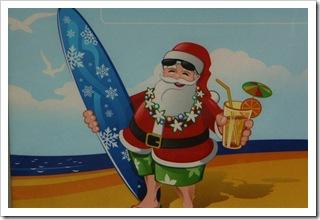 Święty Mikołaj na wakacjach - plakat w sklepie